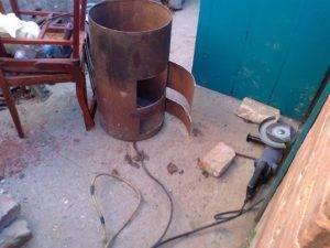Как сделать для гаража печь из дерева или металла длительного горения своими руками, чертежи, инструменты и этапы работы